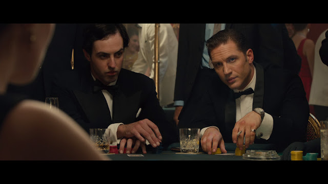 Legend Tom Hardy as Reggie Kray plays cards at Esmeralda's Barn