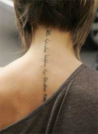 Victoria Beckham Neck Tattoo - Female Celebrity Tattoo Ideas