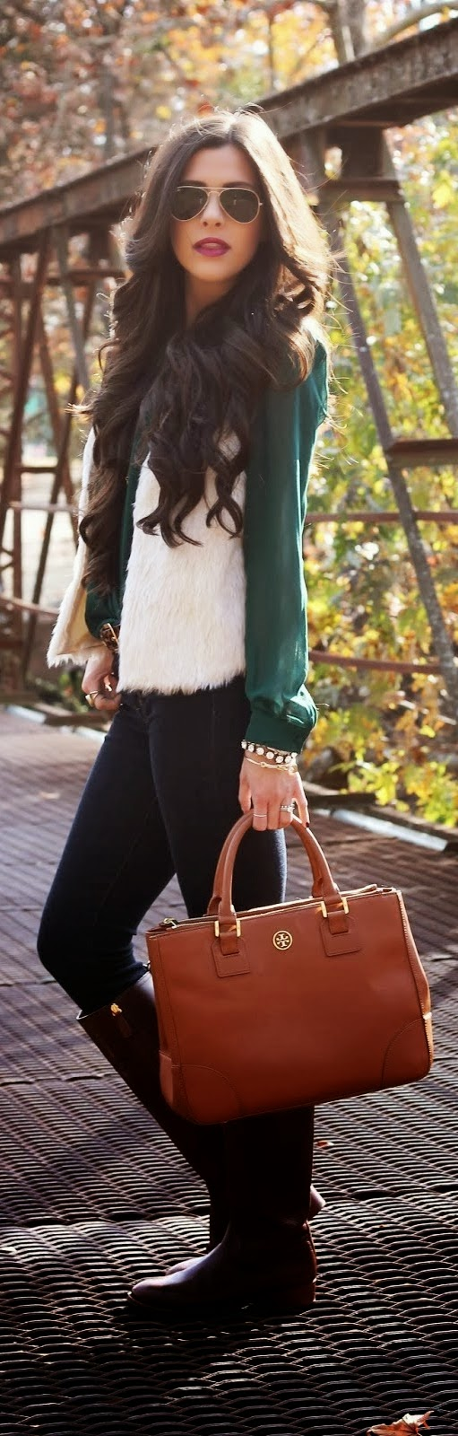 Green shirt, black denim pant and faux fur vest