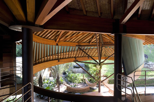 Picture of the leaf house wooden ceiling as seen from the upper floor
