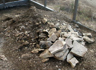 Pile of stones and soil to move