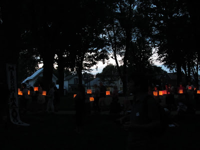 Hiroshima Day Kingston Peace Lantern Ceremony walking with lanterns at dusk
