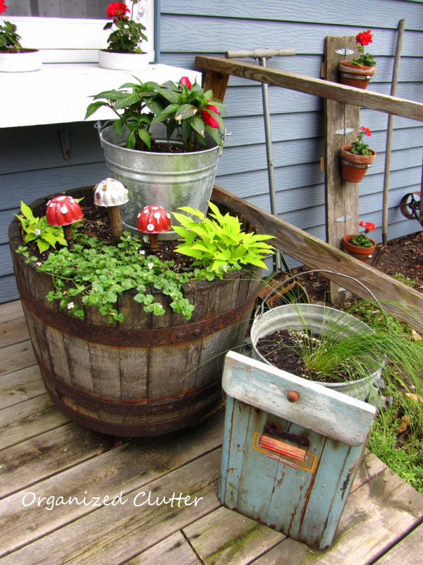 Whiskey Barrel, Buckets, Ice Cream Freezer & Jello Mold Toadstools www.organizedclutterqueen.blogspot.com