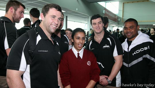 L-R: Ged Robinson; Navreen Nijjar, Sacred Heart College, Napier; Nick McLennan, Mikey Vuicakau, Hawke's Bay Magpies rugby team, returning to Hawke's Bay Airport, Napier, with the Ranfurly Shield, after beating Otago 20-19 in Dunedin on Sunday. photograph