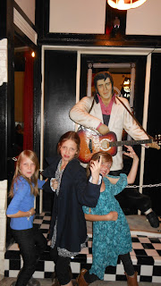 the girls with Elvis statue