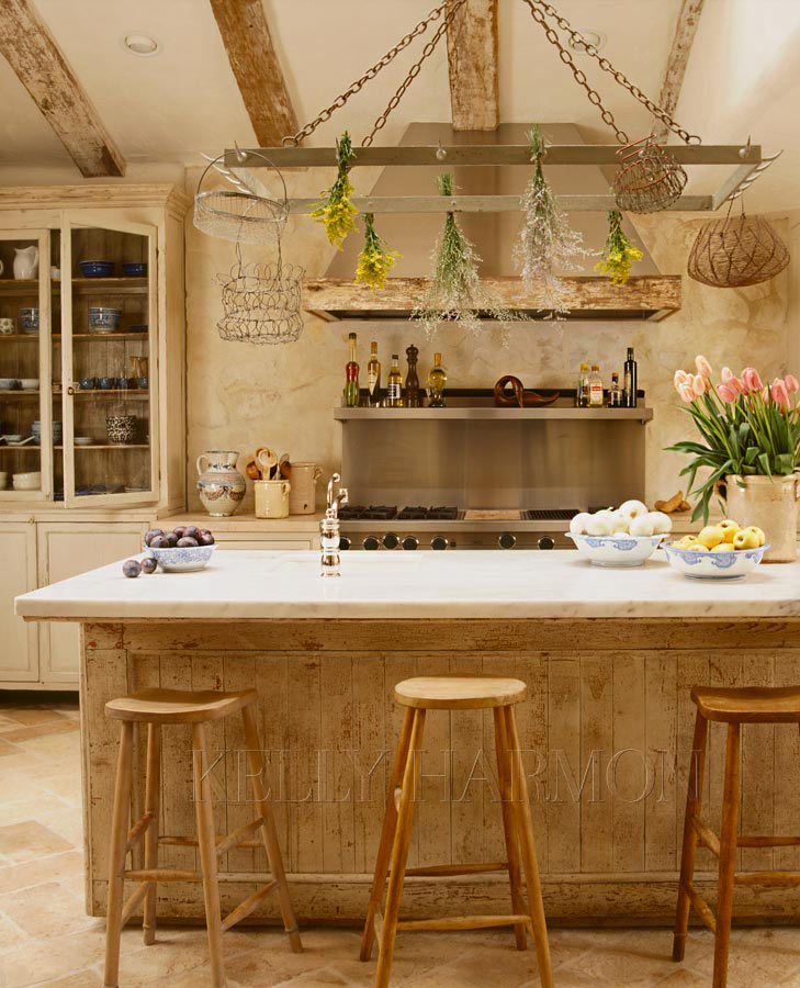 The beamed ceilings and aged wood give this kitchen a warm farmhouse feeling
