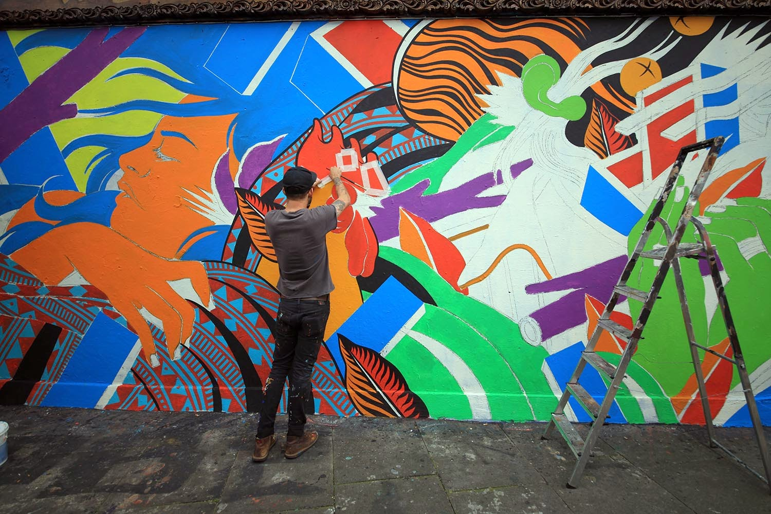 After a massive mural in San Juan, Puerto Rico for Santurce Es Ley 5, Bicicleta Sem Freio have now landed in the United Kingdom where they are currently working on this fresh new piece.