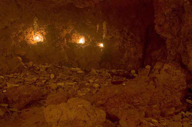 candlelight inside cave