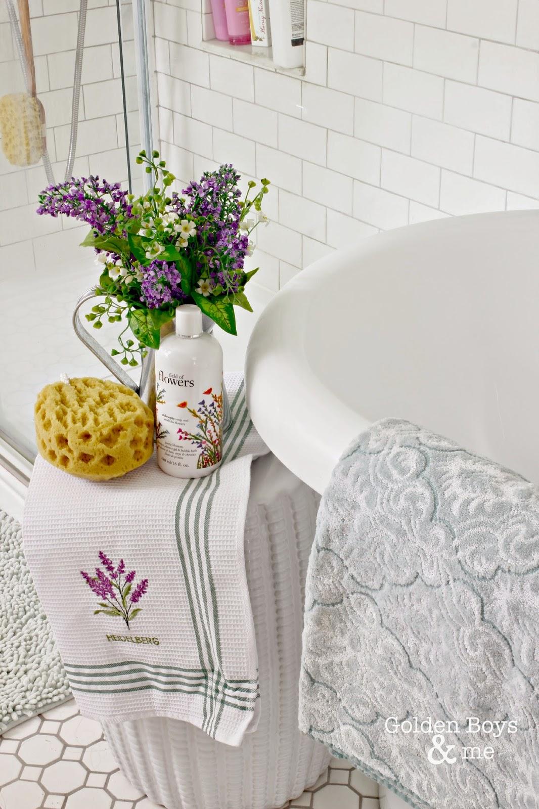 Garden stool in master bathroom next to tub