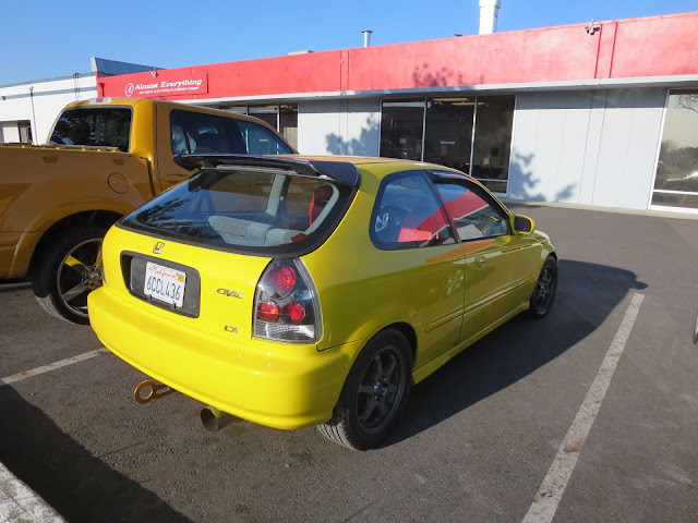 Color change to bright yellow on Honda Civic by Almost Everything Auto Body