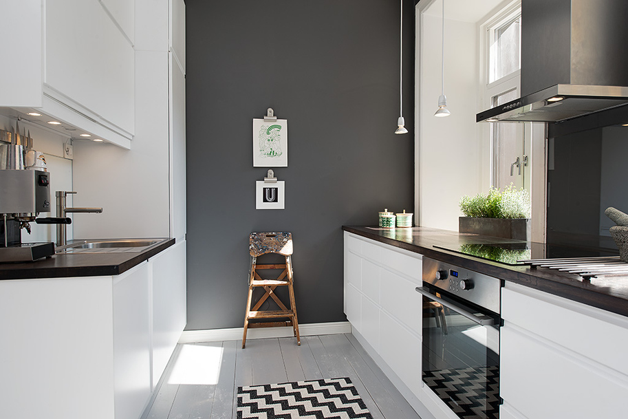 grey wall Mixes very well with the brick wall and the modern kitchen