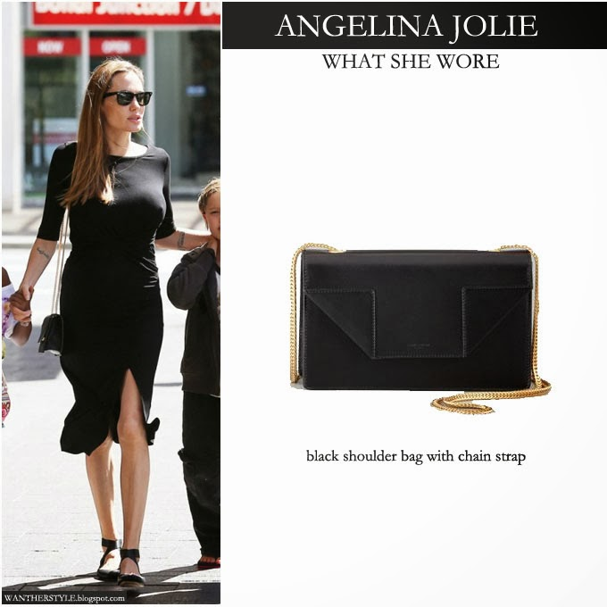 9fdccafb64c5 Angelina Jolie in black midi dress with black chain strap shoulder bag by Saint  Laurent -