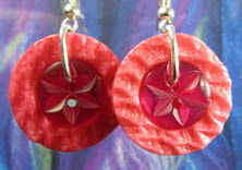 Edgy drop dangle earrings have striking dark pink buttons layered with bright pink textured buttons