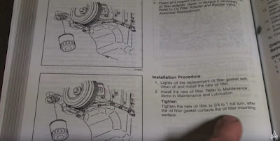 owner's manual depicting installation of new oil filter