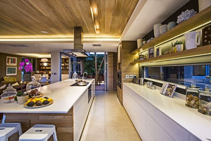 White kitchen in Modern Mansion by Metropole Architects