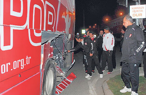 The Samsunspor club bus is seen after colliding with a train