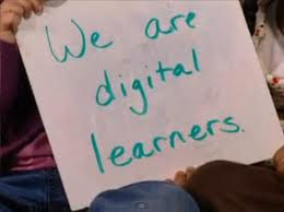 student holding sign saying that he is a 21st century learner