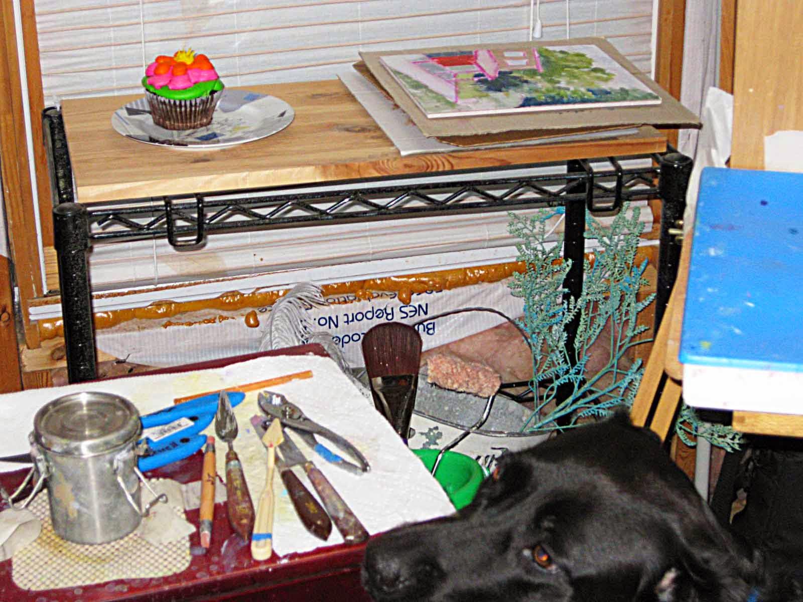Bella sneaking up on cupcake