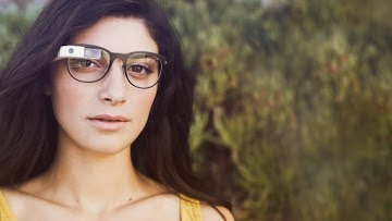 Google Glass displays information in a smartphone-like hands-free format