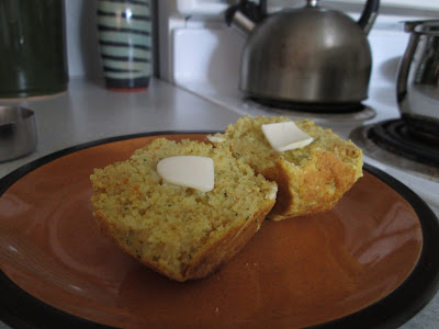 Cornbread muffin on plate with butter