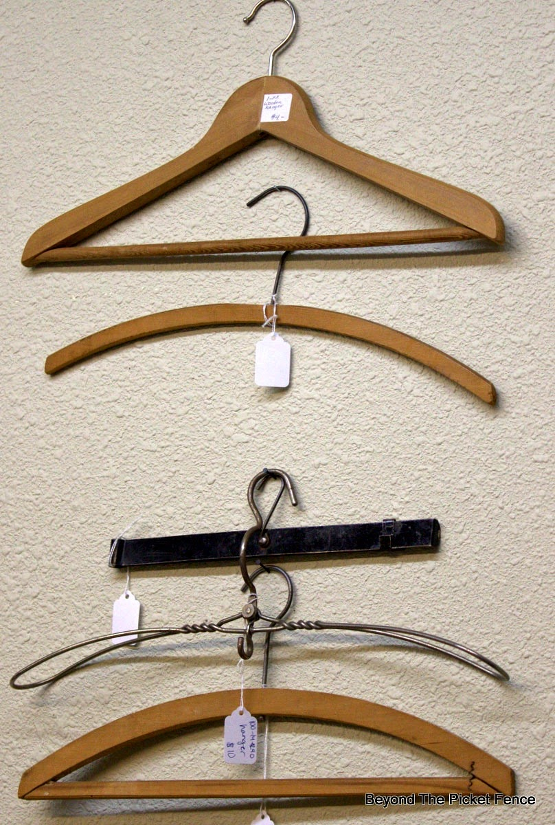 antique hangers, decorating ideas, wall art, Beyond The Picket Fence, http://bec4-beyondthepicketfence.blogspot.com/2015/02/5-decorating-lessons-from-store.html