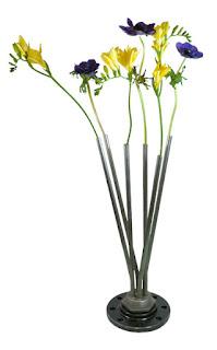 Reciclaje y ahorro hogar con un florero hecho con una resistencia eléctrica