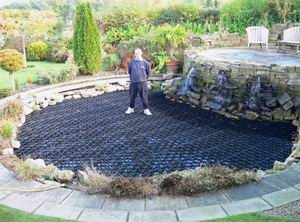 Water feature design child safe ponds for Decorative fish pond covers