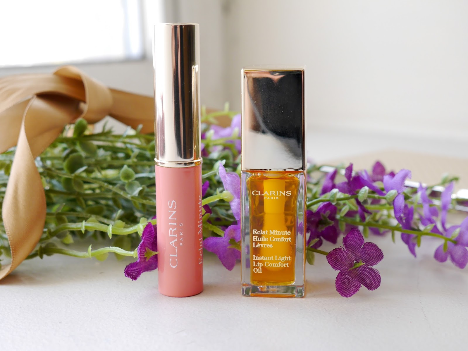 Clarins Lip Comfort Oil honey and Instant Light Lip Balm Protector rose review