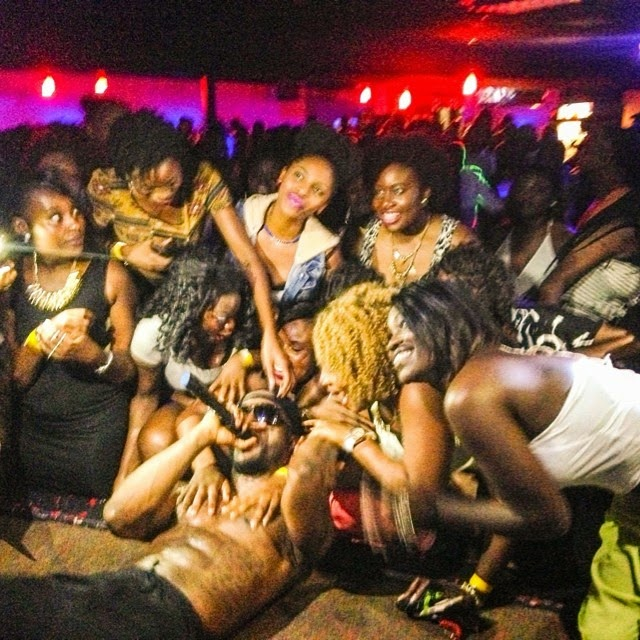 Iyanya's Female Fans Go 'Crazy', Strip Him of His Clothes – Photos