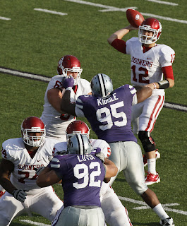 Quarterback Landry Jones #12 of the Oklahoma Sooners passes during a game against the Kansas State Wildcats in the third quarter at Bill Snyder Family Stadium on October 29, 2011 in Manhattan, Kansas. Oklahoma won 58-17. (October 28, 2011 - Source: Ed Zurga/Getty Images North America)