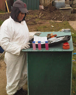 Technician Looking at Packaged Effluent Treatment Plant Sample Analysis