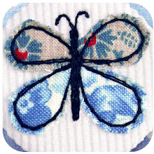 Blue butterfly badge