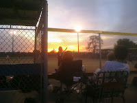 Sunset in Bement, a train going by in the background, and #9 on deck is my #5 daughter Alyssa