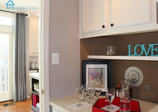 laundry room makeover with bar area and wine holder