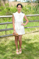 Olivia Munn in a short white dress