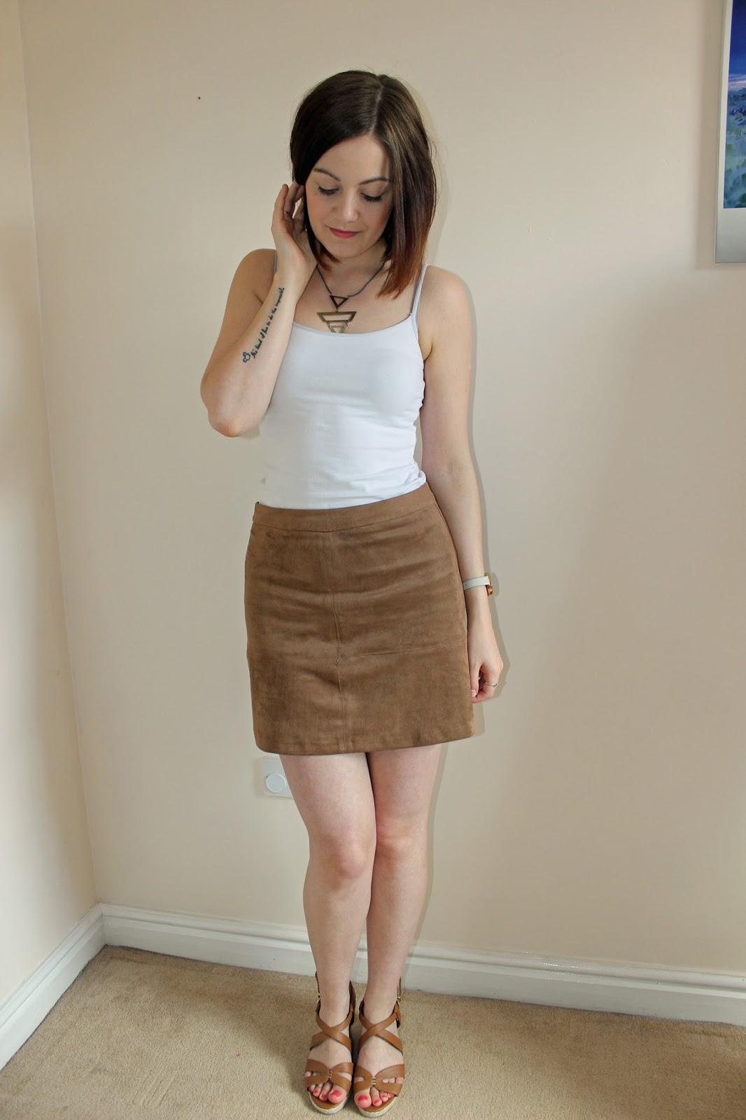 New Look tan suedette a-line skirt, white vest and wide fit tan strap wedges