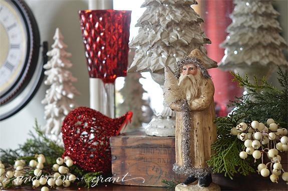 Vintage looking santa on a Christmas mantel   www.andersonandgrant.com