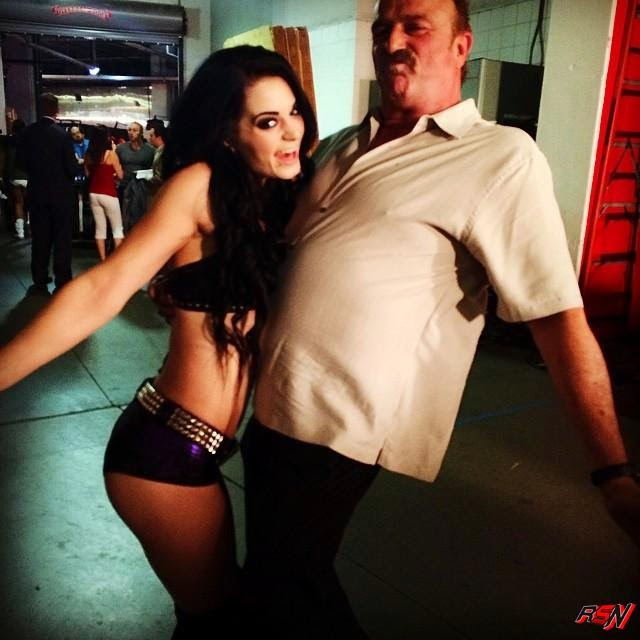 Paige Backstage at SmackDown with Jake Roberts.