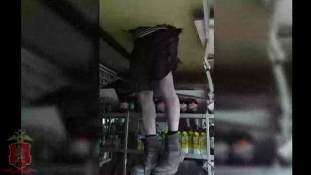 Bungling thief gets stuck in shop's ceiling