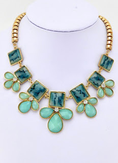 http://www.myvintage.co.uk/retro-necklaces/retro-goldtone-jasper-leaf-square-rhinestone-necklace.html