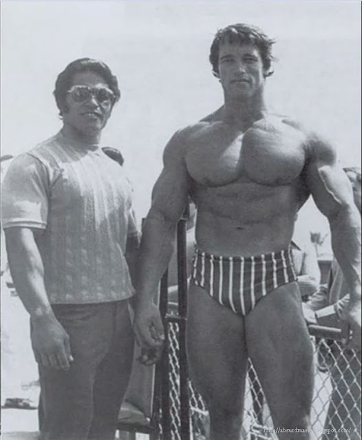 Young Arnold Schwarzeneggger with his gym partner, 1970s