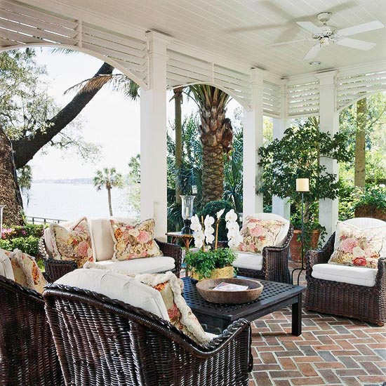 Wicker makes for great porch decor. The foliage around this gorgeous beach front porch is out of a tropical paradise