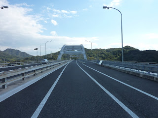View along the road deck of the Omichima arch syle bridge on the Shimanami Kaido bikeway