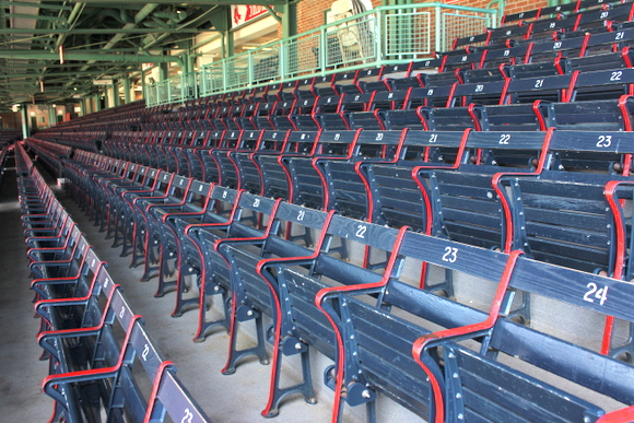 These chairs in Fenway Park are blue and red.