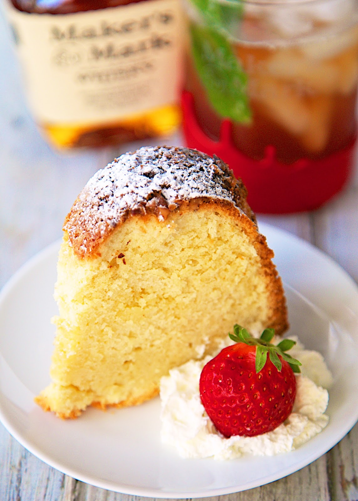 Bourbon Pound Cake Recipe - egg whites are whipped and folded into the batter - makes an amazing pound cake! The bourbon in the cake makes it the perfect treat for watching the Kentucky Derby!
