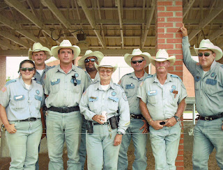 Susan L. Canfield (center) stands among the field force at the Wynne Unit about two weeks before her death.