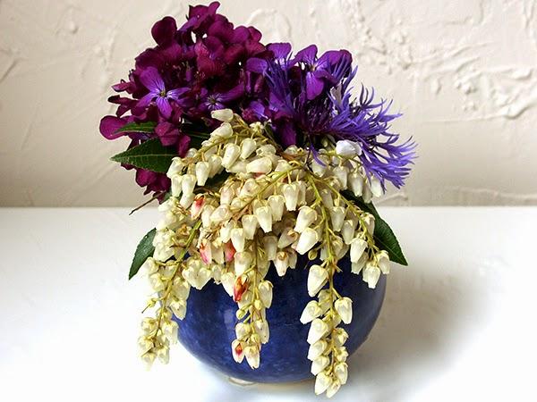 Cascading flower arrangementshttprefreshrosespot purple and white flower arrangements mightylinksfo Images