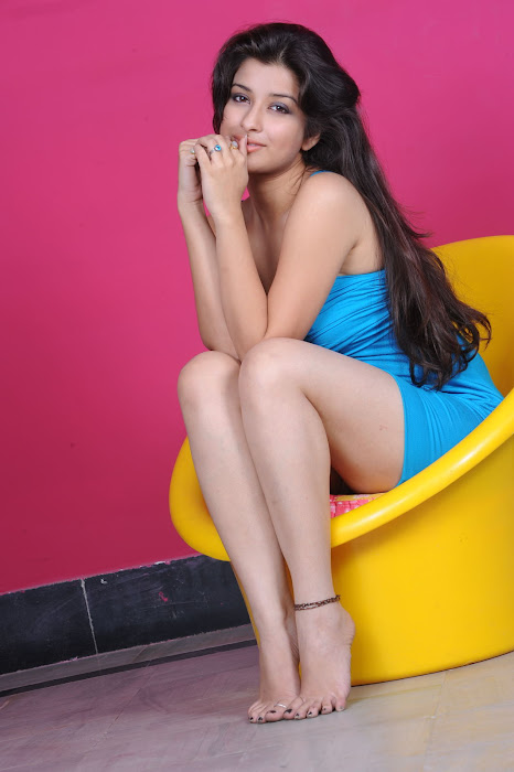 Madhurima in Blue Short Skirt showing her white milky thighs images