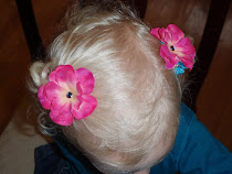 Bright pink flower hair clips with blue accent