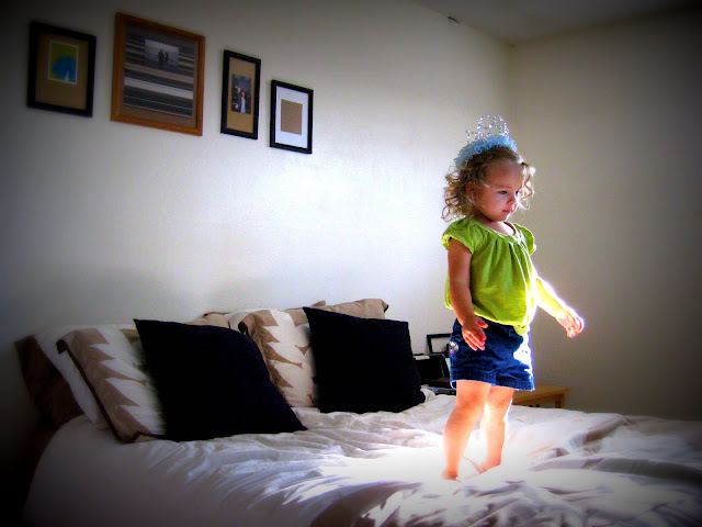 this girl loves jumping on the bed
